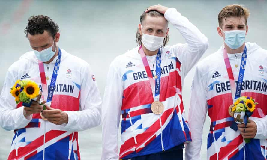 Members of Great Britain's men's eight on the podium with bronze at Sea Forest Waterway in Tokyo