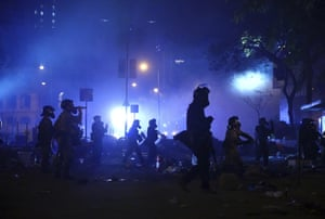 Riot police enter the campus after the all-night standoff