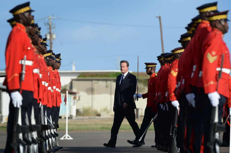 David Cameron (centre), then UK prime minister, in Jamaica in 2015.