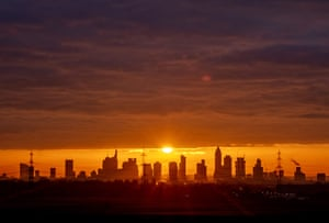 The sun rises over the banking district in Frankfurt, Germany