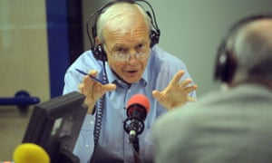 Humphrys prepares to grill an interview subject in the radio studio.