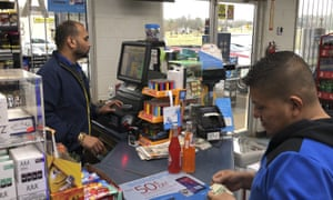 Jee Patel checks out a customer at the KC Mart in Simpsonville, South Carolina.