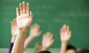 children with hands in the air