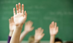 Hands raised in a classroom