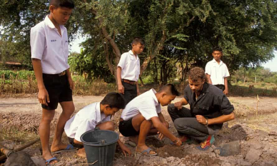 A VSO volunteer agriculturalist working in a school garden in Kanchanaburi, Thailand