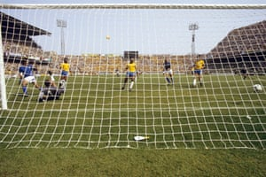 Rossi slides the ball past Brazil goalkeeper Waldir Peres to score his hat-trick.