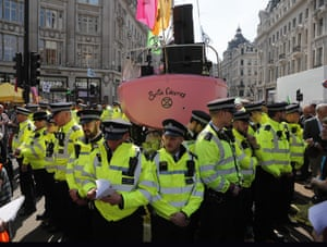 Officers surround the pink boat