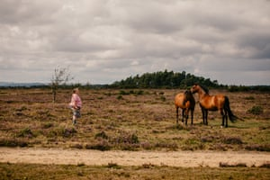 New Forest commoner Ann Sevier with two Commoner-owned horses