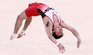 Kohei Uchimura of Japan competes on the floor during the men's gymnastics team final