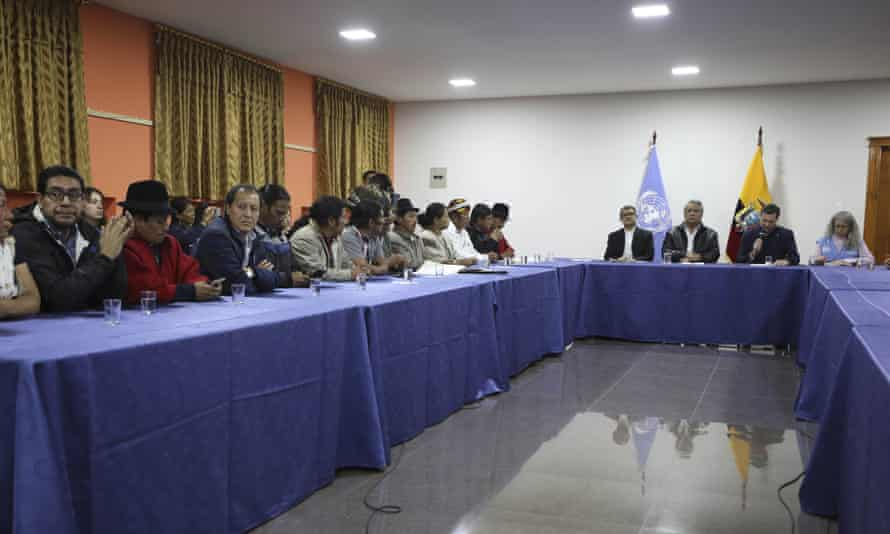 Indigenous leaders (eft) attend negotiations with President Lenín Moreno (third from right) in Quito