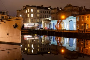 Chitra Ramaswamy's words is projected on to Leith Custom House