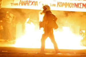Anti-austerity protesters throw petrol bombs at riot police during clashes in Athens