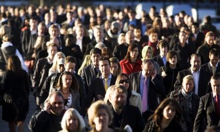 People walk across London Bridge