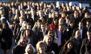 Commuters walk across London Bridge, 17 October 2008