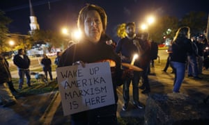 Dana Farley of New Orleans participates in a candlelight vigil at the statue of Jefferson Davis in New Orleans on 24 April 2017.
