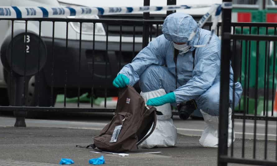 Forensic officer examines items