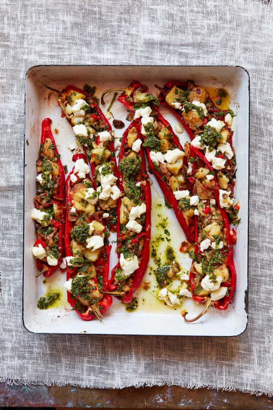 Thomasina Miers' romano peppers stuffed with herbs, olives and goat's cheese.