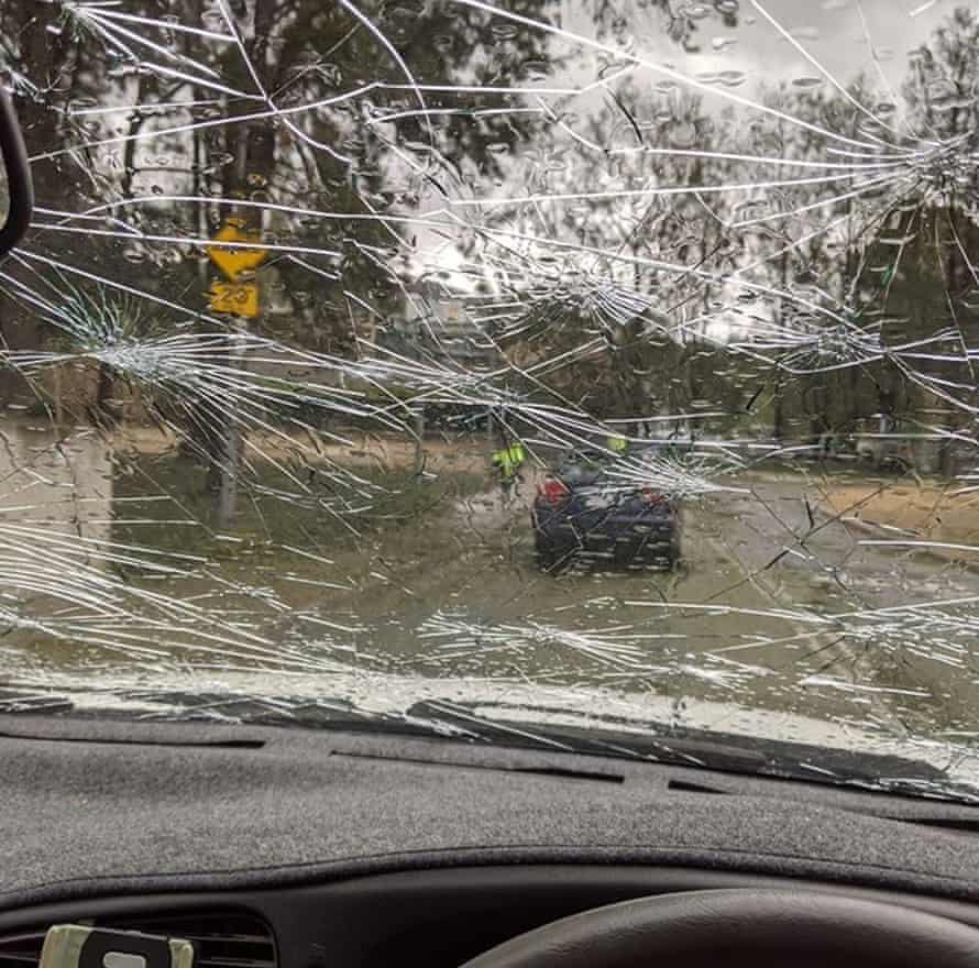 A car windshield is smashed by hail in Canberra