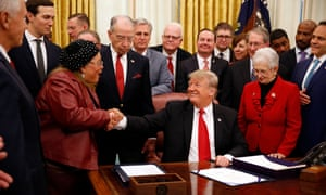 Donald Trump is congratulated by author and activist Alveda King, niece of the Rev Martin Luther King Jr, after the president signed the First Step Act criminal justice reform bill.
