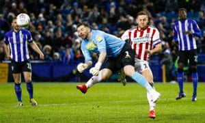 Sheffield Wednesday goalkeeper Keiren Westwood beats Sheffield United forward Billy Sharp