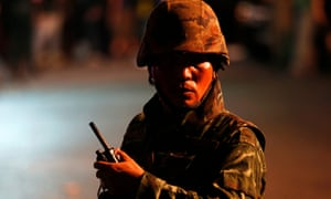 A Thai soldier secures the area after an explosion outside the Erawan shrine, which is popular with tourists