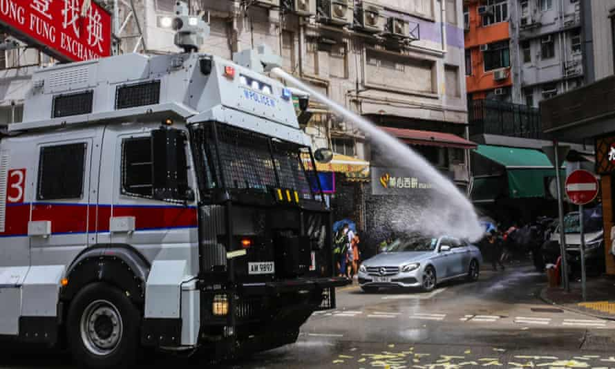 A deployed water cannon targets protesters in Hong Kong.