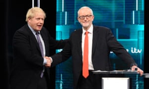 Boris Johnson and Jeremy Corbyn shake hands during their election head-to-head debate live on ITV
