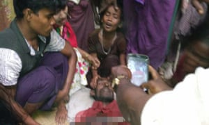 A Rohingya reporter photographs a man allegedly shot by security forces in Rakhine.