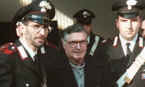 Salvatore 'Toto' Riina is led handcuffed into Bologna's bunker-courtroom