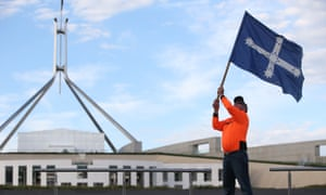 CFMEU Canberra member Dusty Miller who once poured concrete when Parliament House was being built waves the Eureka flag on the front lawns of Parliament House, Canberra, 7 February 2018.