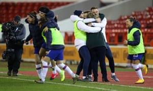 Chelsea manager Emma Hayes, is congratulated by members of her staff at full time.