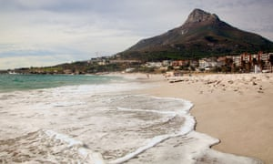 View along surf and beach to mountain at Camps Bay, Cape Town,