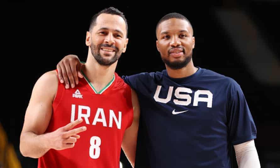 Iran's Saeid Davarpanah and USA's Damian Lillard embrace following their match.