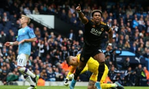 Adama Traore celebrates the first of his two goals for Wolves at the Etihad Stadium in October