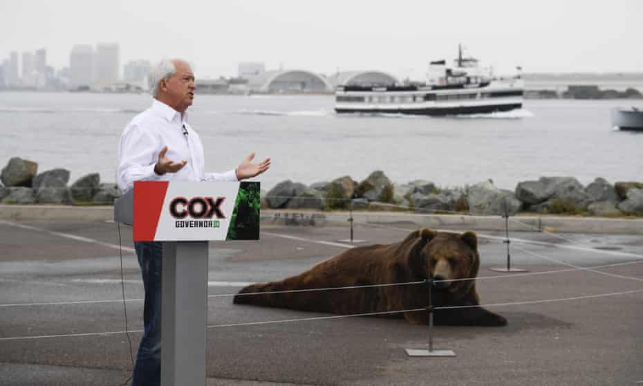 John Cox speaks in front of his Kodiak bear at a campaign event held on Shelter Island in San Diego.
