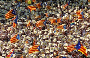 People hold Catalan separatist flags known as 'Esteladas' during a gathering to mark the Catalonia day Diada in central Barcelona.