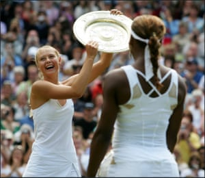 MARIA SHARAPOVA HOLDS UP THE TROPHY AFTER SHE BEAT SERENA WILLIAMS TO WIN THE 2004 WOMENS SINGLES TITLE ON CENTRE COURT