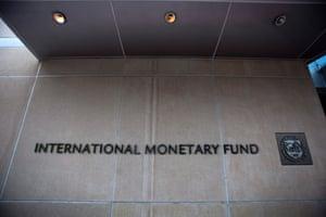 The logo and name of the International Monetary Fund (IMF) at the entrance of its Washington headquarters.