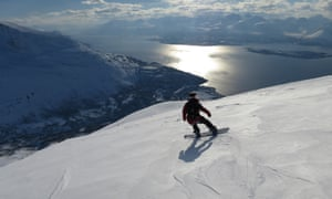Writer Sam Haddad snowboards down the peak in the Lyngen Alps, Norway.