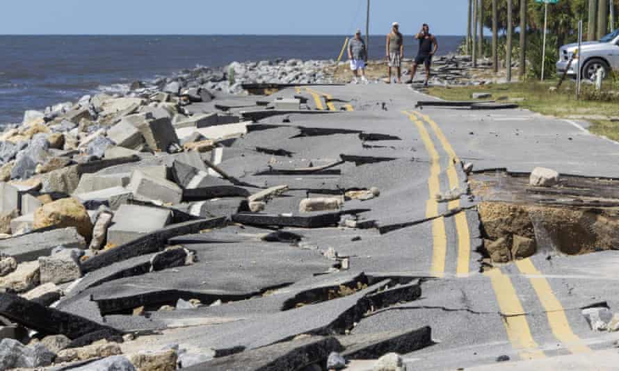 BResidents look at a road that collapsed during the storm surge from Hermine at Alligator Point, Florida, on Friday. Photograph: Mark Wallheiser/Getty Images