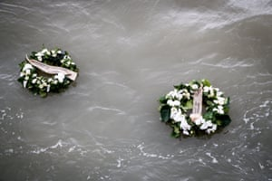 Zeebrugge, Belgium. Wreaths thrown in to the sea during a ceremony marking the 30th anniversary of the Herald of Free Enterprise ferry disaster that claimed 193 lives