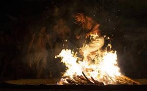 A man performs a flame dance on Sorte Mountain