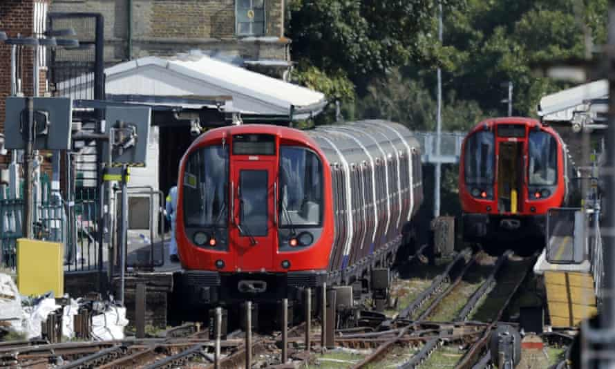 A forensic officer walks beside a train at Parsons Green last September