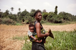 Woman carrying baby in Bayelsa