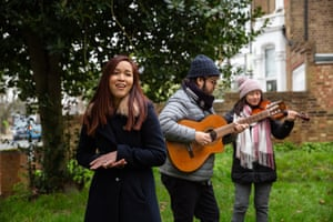 Amy Tan and fellow members of the Covid-19 Mutual Aid musicians' group perform in west London before the two-metre rule was implemented
