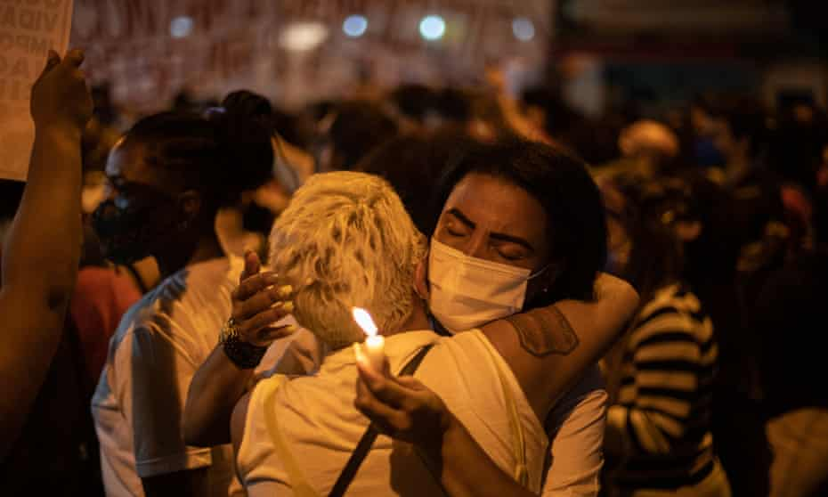 Demonstrators gather and embrace at a protest to denounce the deadliest police operation in Rio history in Jacarezinho.