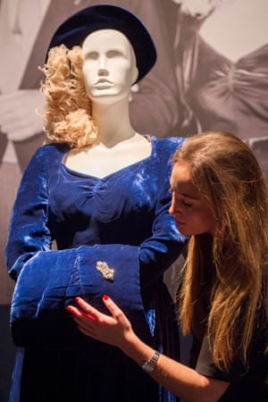 A Christie's staff member adjusts Margaret Thatcher's wedding dress.