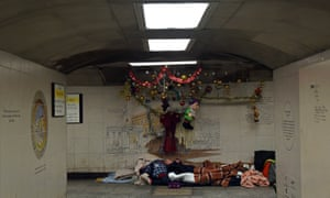 A homeless man with Christmas decorations.