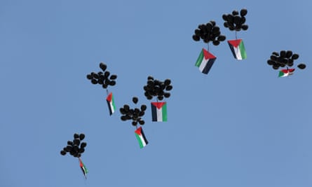 Balloons with Palestinian flags released by protesters in Ramallah, May 2018