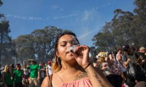 A smoking marijuana in Golden Gate Park in San Francisco, California, celebrating the annual 4/20 festival.